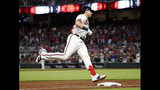 Atlanta Braves left fielder Austin Riley (27) rounds third base after hitting a three-run home run in the sixth inning of a baseball game against the Philadelphia Phillies Wednesday, July 3, 2019, in Atlanta. (AP Photo/John Bazemore)