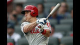 Philadelphia Phillies' J.T. Realmuto drives in a run with a base hit during the first inning of the team's baseball game against the Atlanta Braves on Thursday, July 4, 2019, in Atlanta. (AP Photo/John Bazemore)