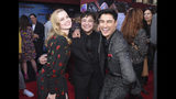 """This June 26, 2019 photo released by Sony Pictures shows, from left, Angourie Rice, Zach Barack and Remy Hii at the world premiere of """"Spider-Man: Far From Home"""" at the TCL Chinese Theatre in Los Angeles.Barack, who plays the first openly transgender actor in the Marvel Universe, says there needs to be more express representation of his experience. Superhero movies """"always felt like a trans story because it's talking about identity,"""" said Barack at last month's premiere of """"Spider-Man: Far From Home,"""" in which he plays a classmate of Peter Parker's. His gender identity is not addressed in the movie. (Stewart Cook/Sony Pictures via AP)"""