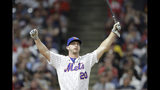 Pete Alonso, of the New York Mets, reacts after hitting during the first round in the Major League Baseball Home Run Derby, Monday, July 8, 2019, in Cleveland. The MLB baseball All-Star Game will be played Tuesday. (AP Photo/Tony Dejak)