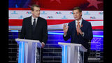 CORRECTS BENNET'S TITLE TO SENATOR, INSTEAD OF FORMER SENATOR - Democratic presidential candidate Rep. Eric Swalwell, D-Calif., right, speaks during the Democratic primary debate hosted by NBC News at the Adrienne Arsht Center for the Performing Arts, Thursday, June 27, 2019, in Miami, as Colorado Sen. Michael Bennet watches. (AP Photo/Wilfredo Lee)
