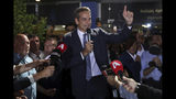 Greek opposition New Democracy conservative party leader Kyriakos Mitsotakis talks to his supporters at the New Democracy headquarters in Athens, on Sunday, July 7, 2019. Official results from nearly 60% of ballots counted showed the conservative New Democracy party of Kyriakos Mitsotakis winning comfortably with 39.7% compared to Tsipras' Syriza party with 31.5%. (AP Photo/Petros Giannakouris)