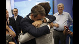 Greek opposition New Democracy conservative party leader Kyriakos Mitsotakis embrace his son after win the parliamentary elections at the New Democracy headquarters in Athens, on Sunday, July 7, 2019. Official results from nearly 60% of ballots counted showed the conservative New Democracy party of Kyriakos Mitsotakis winning comfortably with 39.7% compared to Tsipras' Syriza party with 31.5%. (AP Photo/Thanassis Stavrakis)