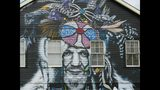 This mural of musician Dr. John, seen in a Feb. 22, 2019 photo, is among nearly two dozen created through Neal Morris's NOLA Murals Project after Morris sued New Orleans to overturn its murals regulation. The lawsuit was scheduled for a hearing Tuesday, July 8, on Morris' request to decide it without a full trial. (AP Photo/Janet McConnaughey)