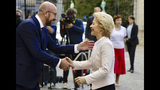 Germany's Defense Minister Ursula von der Leyen is welcomed by Belgian Prime Minister Charles Michel prior to a meeting at the Egmont Palace in Brussels, Monday July 8, 2019. Germany's Ursula von der Leyen has been nominated to become the next president of the European Commission, while Belgian Prime Minister Charles Michel has been appointed to take over as president of the European Council. (AP Photo/Olivier Matthys)