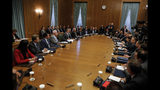 Greece's new government participate in the first cabinet meeting in Athens, Wednesday, July 10, 2019. Conservative party leader Kyriakos Mitsotakis won Sunday's election on pledges that included making the country more businesses-friendly, cutting taxes and negotiating an easing of draconian budget conditions agreed as part of the country's rescue program. (AP Photo/Petros Giannakouris)
