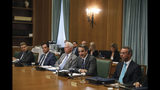 Greek Prime Ministers Kyriakos Mitsotakis, second right, speaks next to Finance Minister Christos Staikouras, right, as the new government participate in their first cabinet meeting, in Athens, Wednesday, July 10, 2019. Conservative party leader Kyriakos Mitsotakis won Sunday's election on pledges that included making the country more businesses-friendly, cutting taxes and negotiating an easing of draconian budget conditions agreed as part of the country's rescue program. (AP Photo/Petros Giannakouris)
