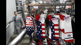 Red, white and blue socks are prominently displayed in an athletic clothing store one day ahead of a ticker-tape parade for the U.S. Women's Soccer World Cup winning team, Tuesday, July 9, 2019, in New York. (AP Photo/Kathy Willens)