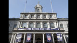 Workers prepare New York's City Hall, decorated with banners in preparation for a ceremony with Mayor Bill de Blasio and other dignitaries scheduled to follow Wednesday's ticker-tape parade for the four-time World Cup winning U.S. Women's soccer team, Tuesday, July 9, 2019, in New York. (AP Photo/Kathy Willens)