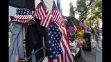 """Red, white and blue flag-themed hats and other items are for sale along Broadway, also known as the """"Canyon of Champions,"""" in lower Manhattan, one day ahead of a ticker-tape parade and City Hall ceremony for the four-time World Cup winning U.S. Women's soccer team, Tuesday, July 9, 2019, in New York. (AP Photo/Kathy Willens)"""