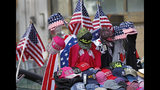 """Flag-themed souvenirs are for sale on Broadway, also known as the """"Canyon of Champions,"""" along the parade route in lower Manhattan, one day ahead of a ticker-tape parade and City Hall ceremony for the four-time World Cup winning U.S. women's soccer team, Tuesday, July 9, 2019, in New York. (AP Photo/Kathy Willens)"""