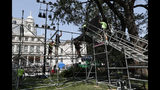 Workers construct a high platform for media one day ahead of a City Hall ceremony that will follow a ticker-tape parade for the U.S. Women's soccer team, four-time World Cup winners, Tuesday, July 9, 2019, in New York. (AP Photo/Kathy Willens)
