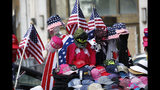 """Flag-themed souvenirs are for sale along Broadway, also known as the """"Canyon of Champions,"""" along the parade route in lower Manhattan, one day ahead of a ticker-tape parade and City Hall ceremony for the four-time World Cup winning U.S. women's soccer team, Tuesday, July 9, 2019, in New York. (AP Photo/Kathy Willens)"""