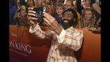 """Donald Glover takes a selfie with fans as he arrives at the world premiere of """"The Lion King"""" on Tuesday, July 9, 2019, at the Dolby Theatre in Los Angeles. (Photo by Chris Pizzello/Invision/AP)"""