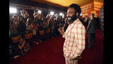 """Donald Glover, a cast member in """"The Lion King,"""" poses at the premiere of the film at the El Capitan Theatre, Tuesday, July 9, 2019, in Los Angeles. (Photo by Chris Pizzello/Invision/AP)"""