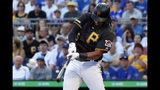FILE - In this July 1, 2019, file photo, Pittsburgh Pirates' Josh Bell hits a three-run home run off Chicago Cubs starting pitcher Adbert Alzolay during the first inning of a baseball game in Pittsburgh. Bell is among eight competitors in this year's All-Star Game Home Run Derby, which is handing out a $1 million prize to the winner. (AP Photo/Gene J. Puskar, File)