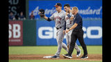 Houston Astros shortstop Alex Bregman (2) is escorted off the field by manager A. J. Hinch (14) and a trainer after taking a ground ball by Texas Rangers' Shin-Soo Choo to the face during the third inning of a baseball game Thursday, July 11, 2019, in Arlington, Texas. Bregman was replaced at shortstop by Myles Straw. (AP Photo/Jeffrey McWhorter)