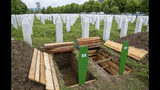 Fresh graves are dug at the memorial cemetery in Potocari near Srebrenica, Bosnia, Wednesday, July 10, 2019. The remains of 33 victims of Srebrenica massacre will be buried on July 11, 2019, 24 years after Serb troops overran the eastern Bosnian Muslim enclave of Srebrenica and executed some 8,000 Muslim men and boys, which international courts have labeled as an act of genocide. (AP Photo/Darko Bandic)