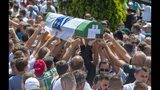 in Potocari near Srebrenica, Bosnia, Thursday, July 11, 2019. Thousands of mourners, including relatives of the victims, are gathering for a commemoration on the 24th anniversary of the Srebrenica massacre, the worst mass killing in Europe since World War II. The ceremony at a memorial site near Srebrenica included the burial of 33 newly identified victims of the July 11-22, 1995 massacre in which more than 8,000 Bosnian Muslim men and boys were killed in and around the U.N.-protected enclave by Bosnian Serb troops during the Bosnian civil war. (AP Photo/Darko Bandic)