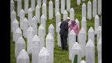 Relatives of victime visit the memorial cemetery in Potocari near Srebrenica, Bosnia, Wednesday, July 10, 2019. The remains of 33 victims of Srebrenica massacre will be buried on July 11, 2019, 24 years after Serb troops overran the eastern Bosnian Muslim enclave of Srebrenica and executed some 8,000 Muslim men and boys, which international courts have labeled as an act of genocide. (AP Photo/Darko Bandic)