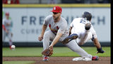 St. Louis Cardinals shortstop Paul DeJong, left, reaches for the ball before tagging out Seattle Mariners' Dylan Moore at second on a stolen-base attempt during the second inning of a baseball game Wednesday, July 3, 2019, in Seattle. (AP Photo/Elaine Thompson)