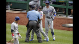 Chicago Cubs manager Joe Maddon, center, yells toward the Pittsburgh Pirates dugout as he is restrained by umpire Joe West and Cubs' Kris Bryant (17) during the fourth inning of a baseball game in Pittsburgh, Thursday, July 4, 2019. Maddon was ejected. (AP Photo/Gene J. Puskar)