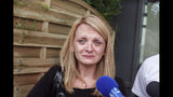 FILE - This July 23 2015 file photo shows Rachel Lambert, wife of Vincent Lambert, crying as she speaks to the media, at the Sebastopol hospital, in Reims, eastern France, where Vincent was on artificial life support. In a vegetative state for 11 years Vincent Lambert who was at the center of a bitter dispute that divided his family and French courts, and provoked national soul-searching over how to deal with terminally ill patients, has died. (AP Photo/Thibault Camus, File)