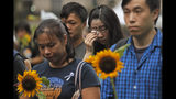 Attendees take part in a public memorial for Marco Leung, a 35-year-old man, who fell to his death weeks ago after hanging a protest banner against an extradition bill in Hong Kong, Thursday, July 11, 2019. The parents of Leung urged young people to stay alive to continue their struggle. (AP Photo/Kin Cheung)