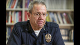 In this Wednesday, July 10, 2019 photo Los Angeles Police Department Chief Michel Moore pauses during an interview with The Associated Press in Los Angeles. Moore says homelessness is a public health and safety concern rather than a law enforcement issue that requires more mental health, sanitation and housing resources. (AP Photo/Damian Dovarganes)