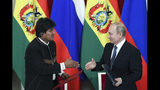 Russian President Vladimir Putin, right, shakes hands with Bolivia's President Evo Morales shake hands during a signing ceremony following their talks in the Kremlin, in Moscow, Russia, Thursday, July 11, 2019. (Kirill Kudryavtsev/Pool Photo via AP)