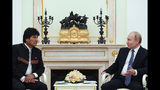 Russian President Vladimir Putin, right, speaks to Bolivia's President Evo Morales during their talks in the Kremlin, in Moscow, Russia, Thursday, July 11, 2019. (Kirill Kudryavtsev/Pool Photo via AP)