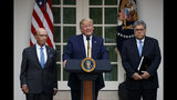 President Donald Trump, joined by Commerce Secretary Wilbur Ross, left, and Attorney General William Barr, speaks during an event about the census in the Rose Garden at the White House in Washington, Thursday, July 11, 2019. (AP Photo/Carolyn Kaster)