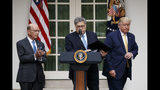 President Donald Trump, joined by Commerce Secretary Wilbur Ross, and Attorney General William Barr, participate in an event about the census and the citizenship question in the Rose Garden at the White House in Washington, Thursday, July 11, 2019. (AP Photo/Carolyn Kaster)