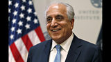 """FILE - In this Feb. 8, 2019, file photo, Special Representative for Afghanistan Reconciliation Zalmay Khalilzad smiles at the U.S. Institute of Peace, in Washington. Amid talk of a U.S. troop withdrawal from Afghanistan, Khalilzad, the U.S. envoy talking to the Taliban said Thursday, July 11, that America is not """"cutting and running"""" from its longest war and that women will continue to have seats in peace talks to end nearly 18 years of fighting. (AP Photo/Jacquelyn Martin, File)"""