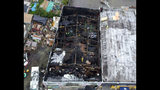 FILE - This undated file photo provided by the City of Oakland shows the burned warehouse after the deadly fire that broke out on Dec. 2, 2016, in Oakland, Calif. Derick Almena, the founder of a California communal living warehouse where a fire killed 36 people more than two years ago, says he's not blaming anyone else in the deadly fire, the East Bay Times reported Thursday, July 11, 2019. (City of Oakland via AP, File)