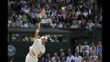 Spain's Roberto Bautista Agut serves to Serbia's Novak Djokovic during a men's singles semifinal match on day eleven of the Wimbledon Tennis Championships in London, Friday, July 12, 2019. . (AP Photo/Ben Curtis)