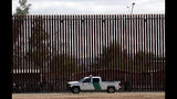 FILE - In this April 5, 2019, file photo, a U.S. Customs and Border Protection vehicle sits near the wall as President Donald Trump visits a new section of the border wall with Mexico in El Centro, Calif. The Trump administration is asking the Supreme Court to allow it to go ahead and use Pentagon money to build sections of a border wall with Mexico after two lower courts blocked it from doing so while a lawsuit over the money proceeds. (AP Photo/Jacquelyn Martin, File)