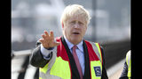 Britain's Conservative Party leadership candidate Boris Johnson during a visit to the port of Dover, southeast England, while on the campaign trail, Thursday July 11, 2019. The two contenders, Jeremy Hunt and Boris Johnson are competing for votes from party members, with the winner replacing Prime Minister Theresa May as party leader and Prime Minister of Britain's ruling Conservative Party. (Chris Ratcliffe/Pool via AP)