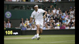 Switzerland's Roger Federer returns the ball to Japan's Kei Nishikori during a men's quarterfinal match on day nine of the Wimbledon Tennis Championships in London, Wednesday, July 10, 2019. (AP Photo/Tim Ireland)