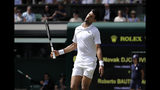 Serbia's Novak Djokovic is dejected after losing a point to Spain's Roberto Bautista Agut during a men's singles semifinal match on day eleven of the Wimbledon Tennis Championships in London, Friday, July 12, 2019. (AP Photo/Ben Curtis)