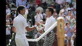 Serbia's Novak Djokovic shakes hands with Spain's Roberto Bautista Agut after defeating him during a men's singles semifinal match on day eleven of the Wimbledon Tennis Championships in London, Friday, July 12, 2019. (AP Photo/Ben Curtis)