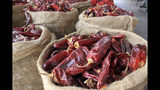"FILE - This March 20, 2013, file photo, shows sacks of dried red chile pods at the Hatch Chile Sales shop along the main street of the self-proclaimed ""Chile Capital of the World,"" in Hatch, N.M. The long-simmering battle between New Mexico and Colorado over which state grows the best chile is heating up. New Mexico Gov. Michelle Lujan Grisham went on the offensive Wednesday, July 10, 2019, after Colorado Gov. Jared Polis proclaimed on Twitter that hot peppers from Pueblo were the best and would be stocked in grocery stores in a four-state region. (AP Photo/Susan Montoya Bryan, File)"