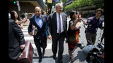 FILE- In this June 21, 2016 file photo Rep. Chaka Fattah, D-Pa., center, leaves the federal courthouse in Philadelphia. Fattah, a longtime Pennsylvania congressman serving a 10-year prison term will ask a judge Friday, July 12, 2019, to reduce his sentence after four bribery and money laundering counts were thrown out on appeal. (AP Photo/Matt Rourke/File)