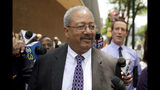 FILE - In this Tuesday, June 21, 2016, file photo, Rep. Chaka Fattah, D-Pa., walks after leaving the federal courthouse in Philadelphia. Fattah, a longtime Pennsylvania congressman serving a 10-year prison term, will ask a judge Friday, July 12, 2019, to reduce his sentence after four bribery and money laundering counts were thrown out on appeal. (AP Photo/Matt Rourke, File)