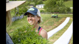In this May 13, 2019 photo, Franny Tacy prepares to plant hemp into a field at her farm in Leicester, N.C. Tacy was a pharmaceutical industry executive for a decade, and also holds a forestry degree from Northern Arizona University in Flagstaff and a master's in education from Tennessee State University. She's also the first female industrial hemp grower in Western North Carolina and, as a woman, part of the fastest-growing farmer demographic in the U.S. (Angela Wilhelm/The Asheville Citizen-Times via AP)
