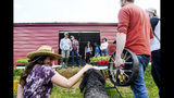 In this May 13, 2019 photo, Jeff and Franny Tacy address a group of volunteers before planting hemp at Franny's Farm in Leicester, N.C. Owned and operated by Franny and her husband and CEO Jeff, Franny's is an active hemp farm in Leicester, and one of the grower sites for North Carolina State University's Industrial Hemp Pilot Research Program. (Angela Wilhelm/The Asheville Citizen-Times via AP)