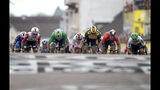 Australia's Caleb Ewan, left, Slovakia's Peter Sagan, second left, and Netherlands' Dylan Groenewegen, center, sprint to the finish line to win the seventh stage of the Tour de France cycling race over 230 kilometers (142,9 miles) with start in Belfort and finish in Chalon sur Saone, France, Friday, July 12, 2019. Groenewegen won the stage. (AP Photo/Christophe Ena)