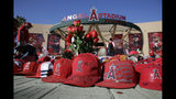 A makeshift shrine in honor of Los Angeles Angels pitcher Tyler Skaggs stands outside Angel Stadium before the team's baseball game against the Seattle Mariners on Friday, July 12, 2019, in Anaheim, Calif. (AP Photo/Marcio Jose Sanchez)