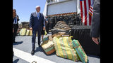 Vice President Mike Pence walks past bales of seized cocaine during a visit to the U.S. Coast Guard Cutter Munro, Thursday, July 11, 2019, in Coronado, Calif. (AP Photo/Denis Poroy)