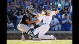 Chicago Cubs' Kris Bryant, right, scores against Pittsburgh Pirates' Jacob Stallings, left, during the eighth inning of a baseball game, Friday, July 12, 2019, in Chicago. (AP Photo/Kamil Krzaczynski)